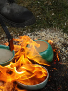 Unique handmade ceramics and pottery Raku pots being glazed in flames